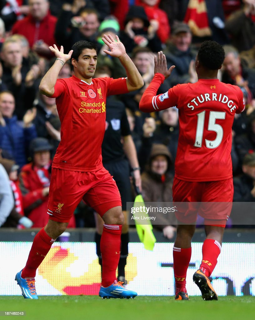 Luis Suarez of Liverpool celebrates scoring the third goal with his team-mate <a gi-track='captionPersonalityLinkClicked' href=/galleries/search?phrase=Daniel+Sturridge&family=editorial&specificpeople=677270 ng-click='$event.stopPropagation()'>Daniel Sturridge</a> during the Barclays Premier League match between Liverpool and Fulham at Anfield on November 9, 2013 in Liverpool, England.
