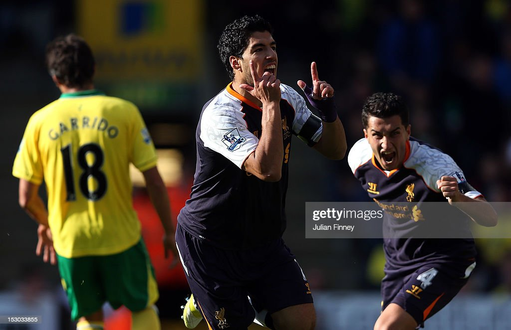 Luis Suarez of Liverpool celebrates scoring their first goal during the Barclays Premier League match between Norwich City and Liverpool at Carrow Road on September 29, 2012 in Norwich, England.