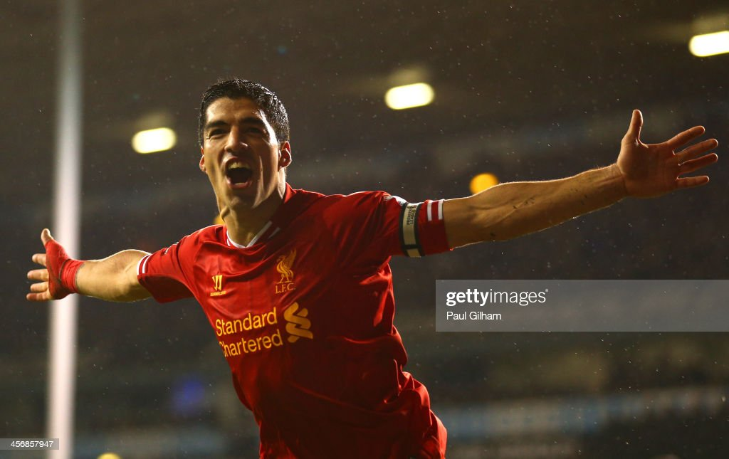 Luis Suarez of Liverpool celebrates scoring their fourth goal during the Barclays Premier League match between Tottenham Hotspur and Liverpool at White Hart Lane on December 15, 2013 in London, England.