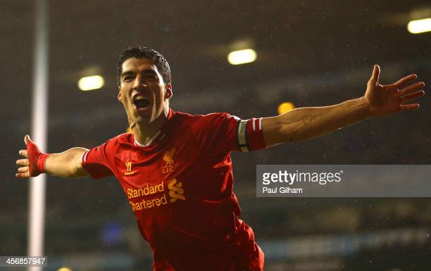 Luis Suarez of Liverpool celebrates scoring their fourth goal during the Barclays Premier League match between Tottenham Hotspur and Liverpool at...