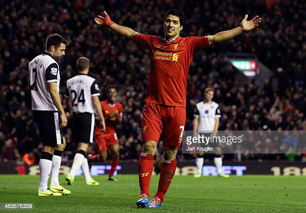 Luis Suarez of Liverpool celebrates setting up the fifth goal for team mate Raheem Sterling during the Barclays Premier League match between...