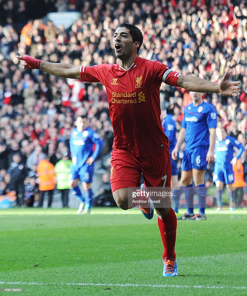 Luis Suarez of Liverpool celebrates the first goal during the Barclays Premier League match between Liverpool and Cardiff City at Anfield on December 21, 2013 in Liverpool, England.