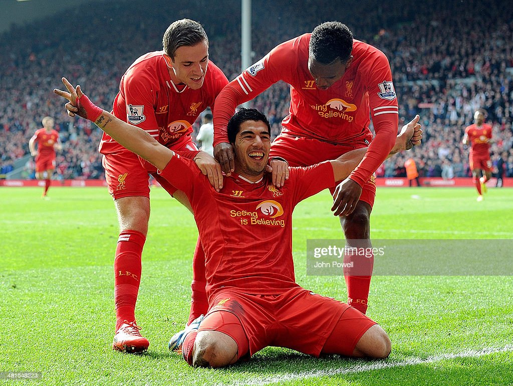 Luis Suarez of Liverpool celebrates the second goal during the Barclays Premier League match between Liverpool and Tottenham Hotspur at Anfield on March 30, 2014 in Liverpool, England.