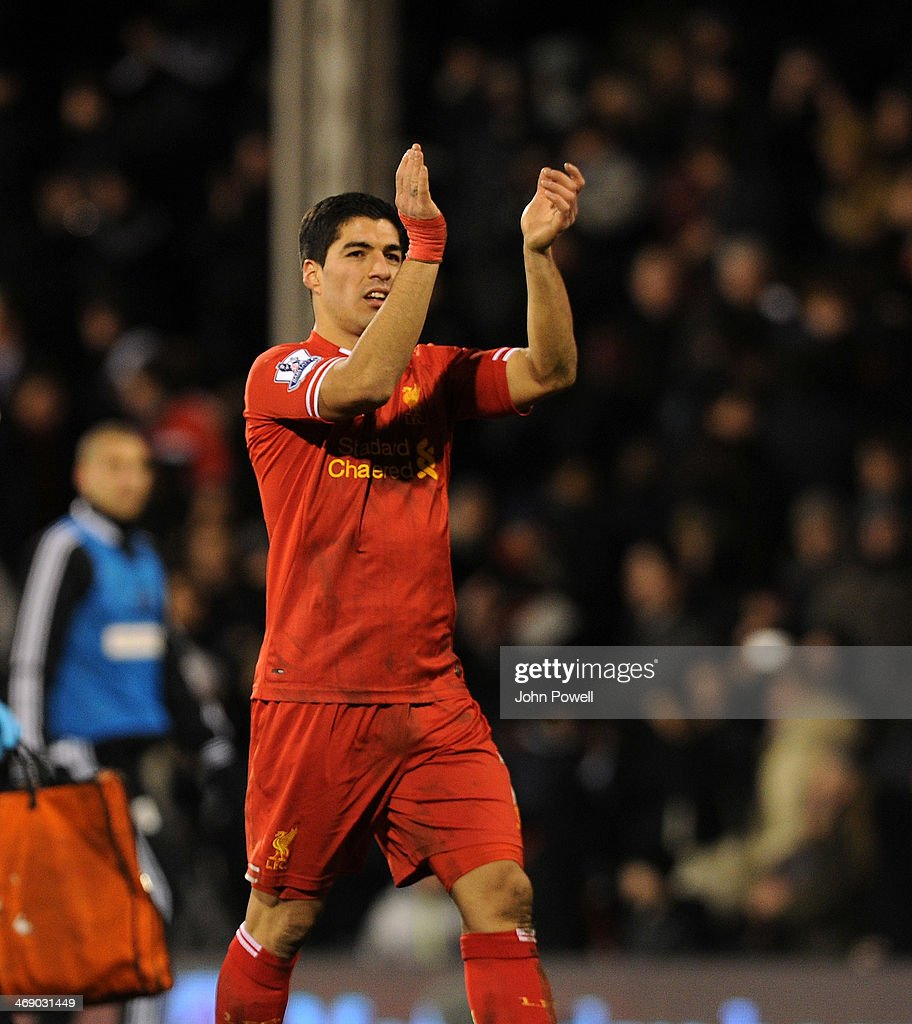 Luis Suarez of Liverpool celebrates the win at the end of the Barclays Premier Leauge match between Fulham and Liverpool at Craven Cottage on February 12, 2014 in London, England.