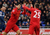 Luis Suarez of Liverpool celebrates with Fabio Borini after scoring the equlising goal during the FA Cup Fourth Round match between Oldham Athletic...
