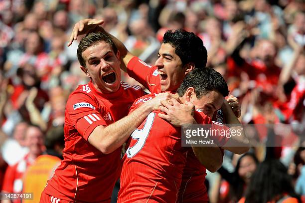 Luis Suarez of Liverpool celebrates with Jordan Henderson and Stewart Downing as he scores their first goal during the FA Cup with Budweiser Semi...