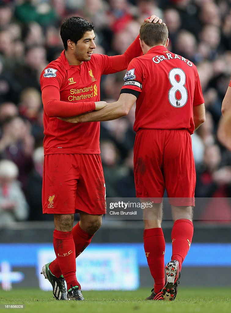 Luis Suarez of Liverpool celebrates with Steven Gerrard after scoring the fourth goal during the Barclays Premier League match between Liverpool and Swansea City at Anfield on February 17, 2013 in Liverpool, England.