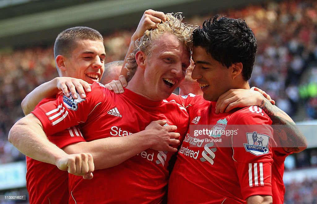 Luis Suarez of Liverpool celebrates with team mate Dirk Kuyt after scoring the third goal during the Barclays Premier League match between Liverpool and Newcastle United at Anfield on May 1, 2011 in Liverpool, England.