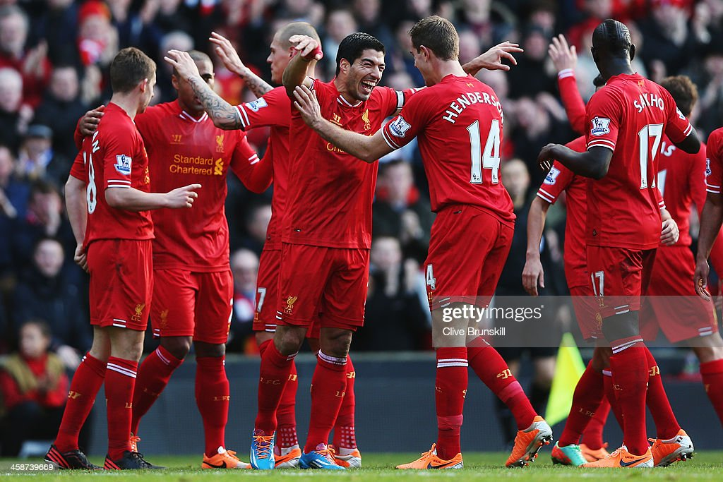 Luis Suarez (C) of Liverpool celebrates with team mates after scoring during the Barclays Premier League match between Liverpool and Cardiff City at Anfield on December 21, 2013 in Liverpool, England.