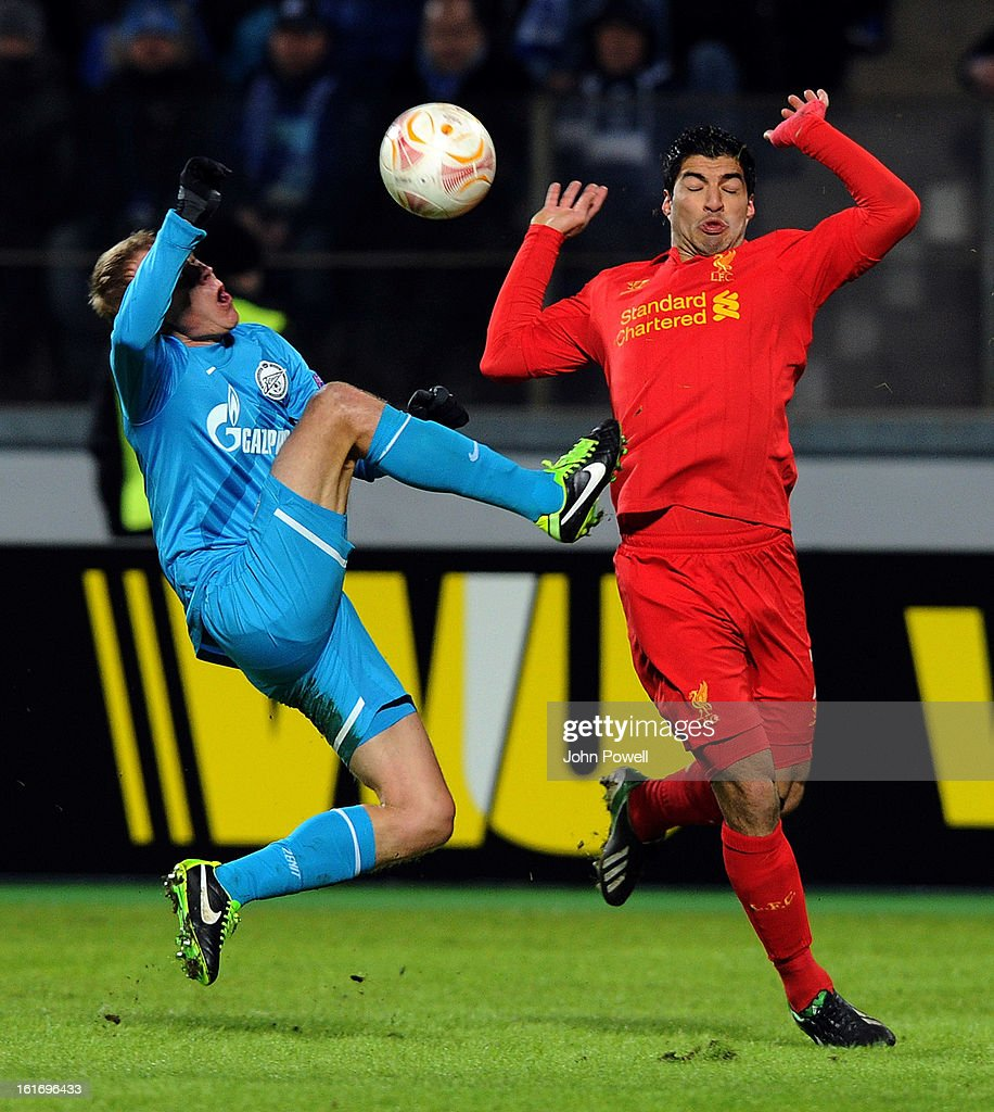 Luis Suarez of Liverpool competes with <a gi-track='captionPersonalityLinkClicked' href=/galleries/search?phrase=Aleksandr+Anyukov&family=editorial&specificpeople=4336248 ng-click='$event.stopPropagation()'>Aleksandr Anyukov</a> of Petersburg v Liverpool FC - UEFA Europa League Round of 32 during the UEFA Europa League round of 32 first leg match between FC Zenit St Petersburg and Liverpool on February 14, 2013 in Saint Petersburg, Russia.