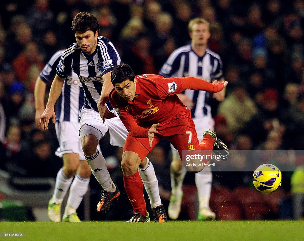 Luis Suarez of Liverpool competes with <a gi-track='captionPersonalityLinkClicked' href=/galleries/search?phrase=Claudio+Yacob&family=editorial&specificpeople=4104249 ng-click='$event.stopPropagation()'>Claudio Yacob</a> of West Bromwich Albion during the Barclays Premier League match between Liverpool and West Bromwich Albion at Anfield on February 11, 2013 in Liverpool, England.
