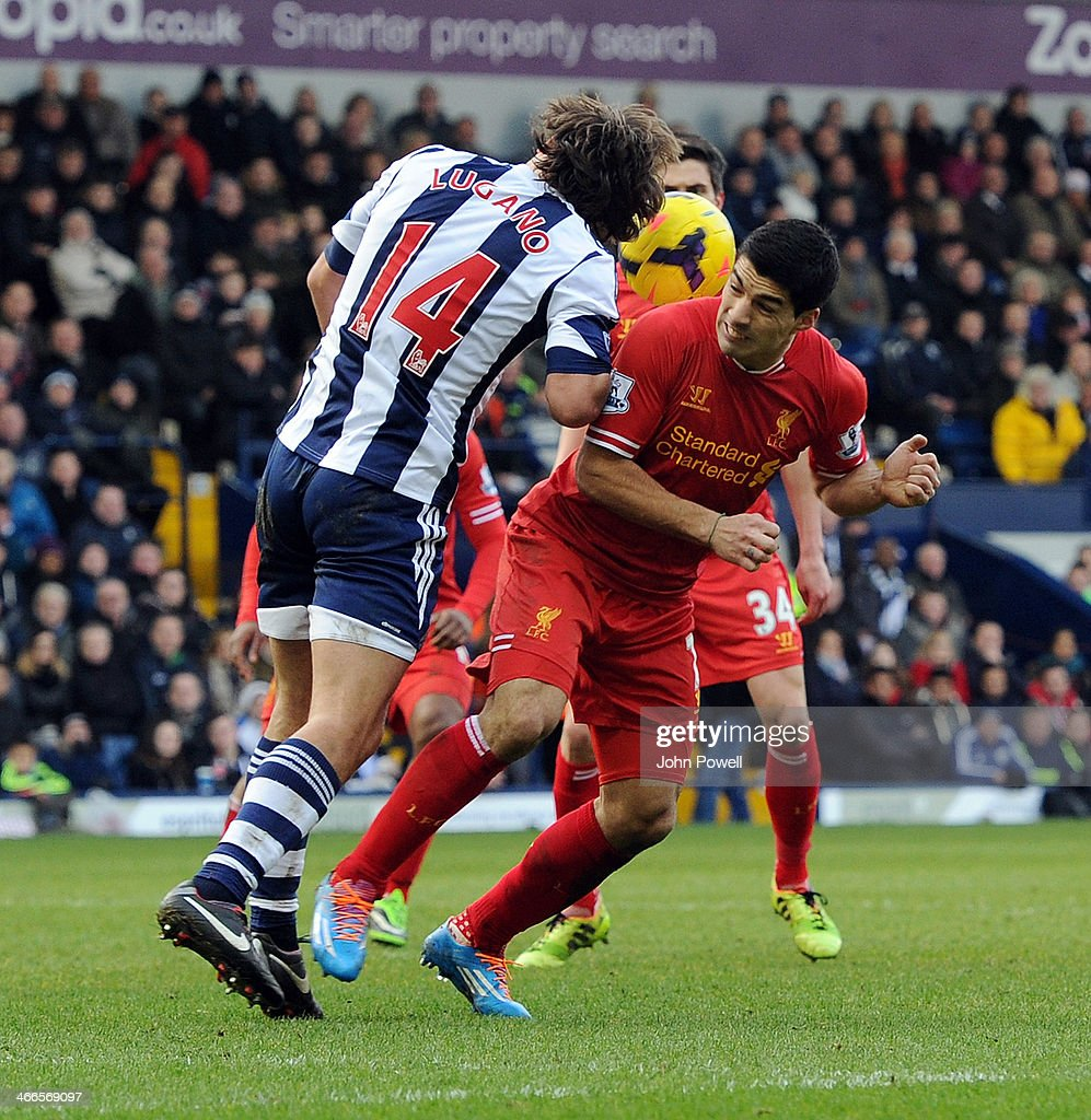 Luis Suarez of Liverpool competes with Diego Lugano of West Bromwich Albion during the Barclays Premier Leauge match between West Bromwich Albion and...