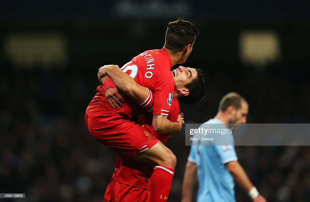 Luis Suarez (R) of Liverpool congratulates goalscorer <a gi-track='captionPersonalityLinkClicked' href=/galleries/search?phrase=Philippe+Coutinho&family=editorial&specificpeople=6735575 ng-click='$event.stopPropagation()'>Philippe Coutinho</a> during the Barclays Premier League match between Manchester City and Liverpool at Etihad Stadium on December 26, 2013 in Manchester, England.