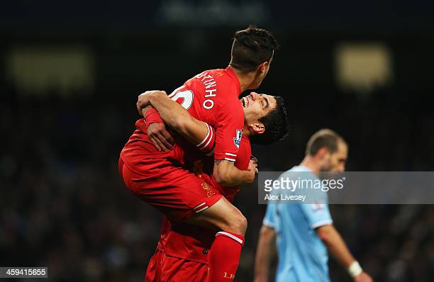 Luis Suarez of Liverpool congratulates goalscorer Philippe Coutinho during the Barclays Premier League match between Manchester City and Liverpool at...
