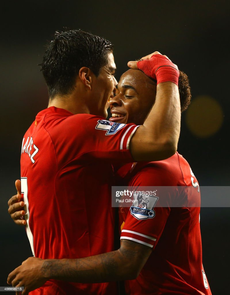 Luis Suarez of Liverpool congratulates <a gi-track='captionPersonalityLinkClicked' href=/galleries/search?phrase=Raheem+Sterling&family=editorial&specificpeople=6489439 ng-click='$event.stopPropagation()'>Raheem Sterling</a> of Liverpool on scoring their fifth goal during the Barclays Premier League match between Tottenham Hotspur and Liverpool at White Hart Lane on December 15, 2013 in London, England.