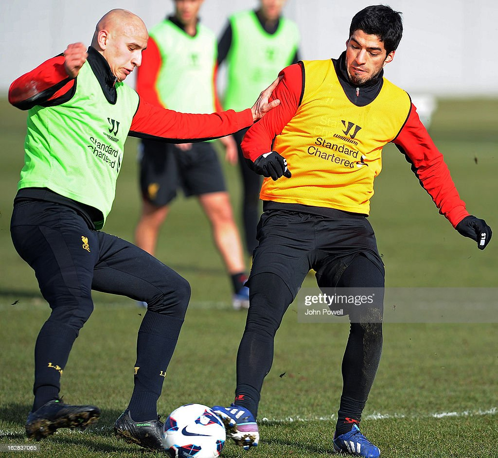 Luis Suarez of Liverpool FC and <a gi-track='captionPersonalityLinkClicked' href=/galleries/search?phrase=Jonjo+Shelvey&family=editorial&specificpeople=4940315 ng-click='$event.stopPropagation()'>Jonjo Shelvey</a> during a training session at Melwood Training Ground on February 28, 2013 in Liverpool, England.
