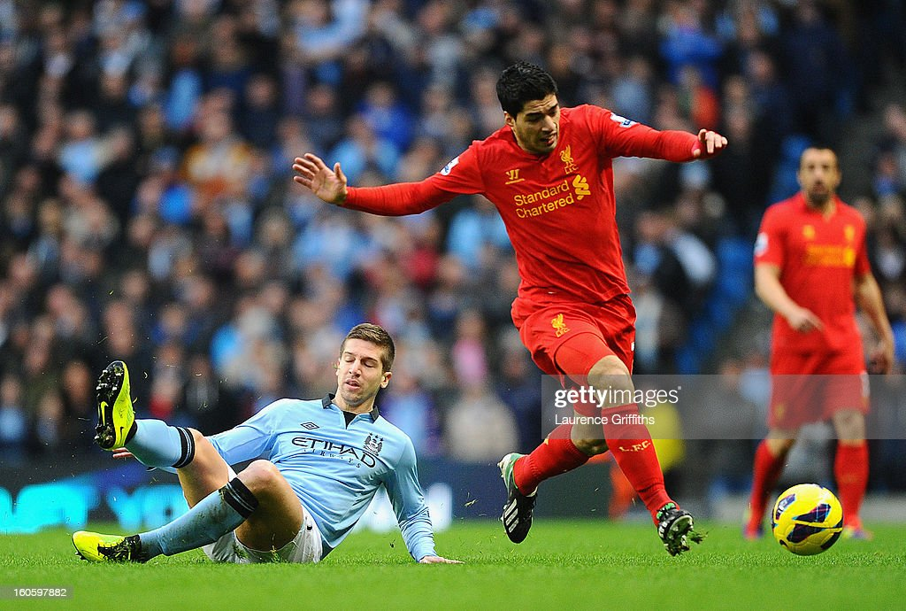 Luis Suarez of Liverpool goes past the challenge of Matija Nastasic of Manchester City during the Barclays Premier League match between Manchester City and Liverpool at the Etihad Stadium on February 3, 2013 in Manchester, England.