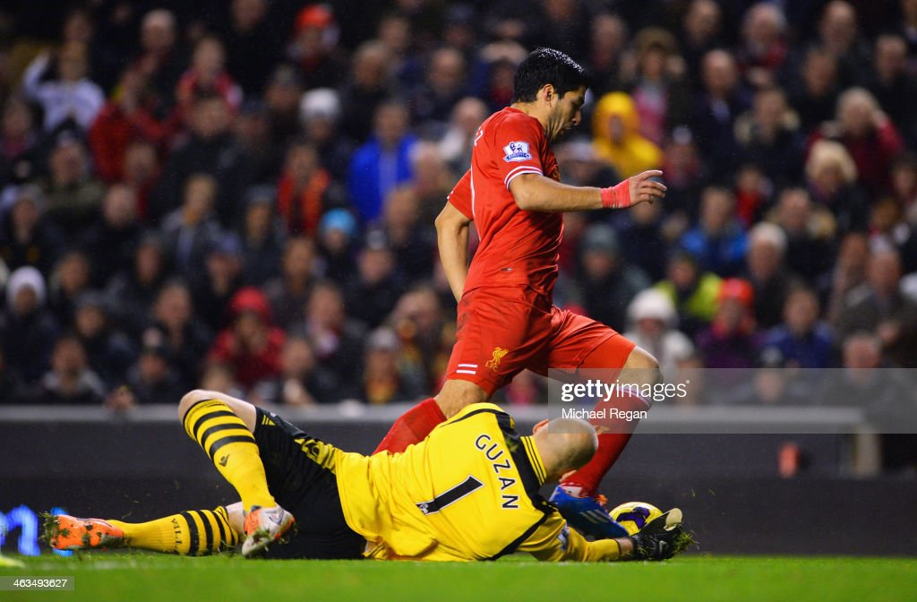 Luis Suarez of Liverpool goes to ground after a challenge by <a gi-track='captionPersonalityLinkClicked' href=/galleries/search?phrase=Brad+Guzan&family=editorial&specificpeople=662127 ng-click='$event.stopPropagation()'>Brad Guzan</a> of Aston Villa leading to a penalty during the Barclays Premier League match between Liverpool and Aston Villa at Anfield on January 18, 2014 in Liverpool, England.