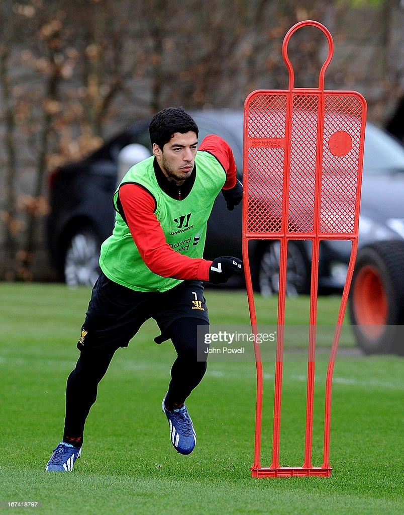 Luis Suarez of Liverpool in aciton during a training session at Melwood Training Ground on April 25, 2013 in Liverpool, England.