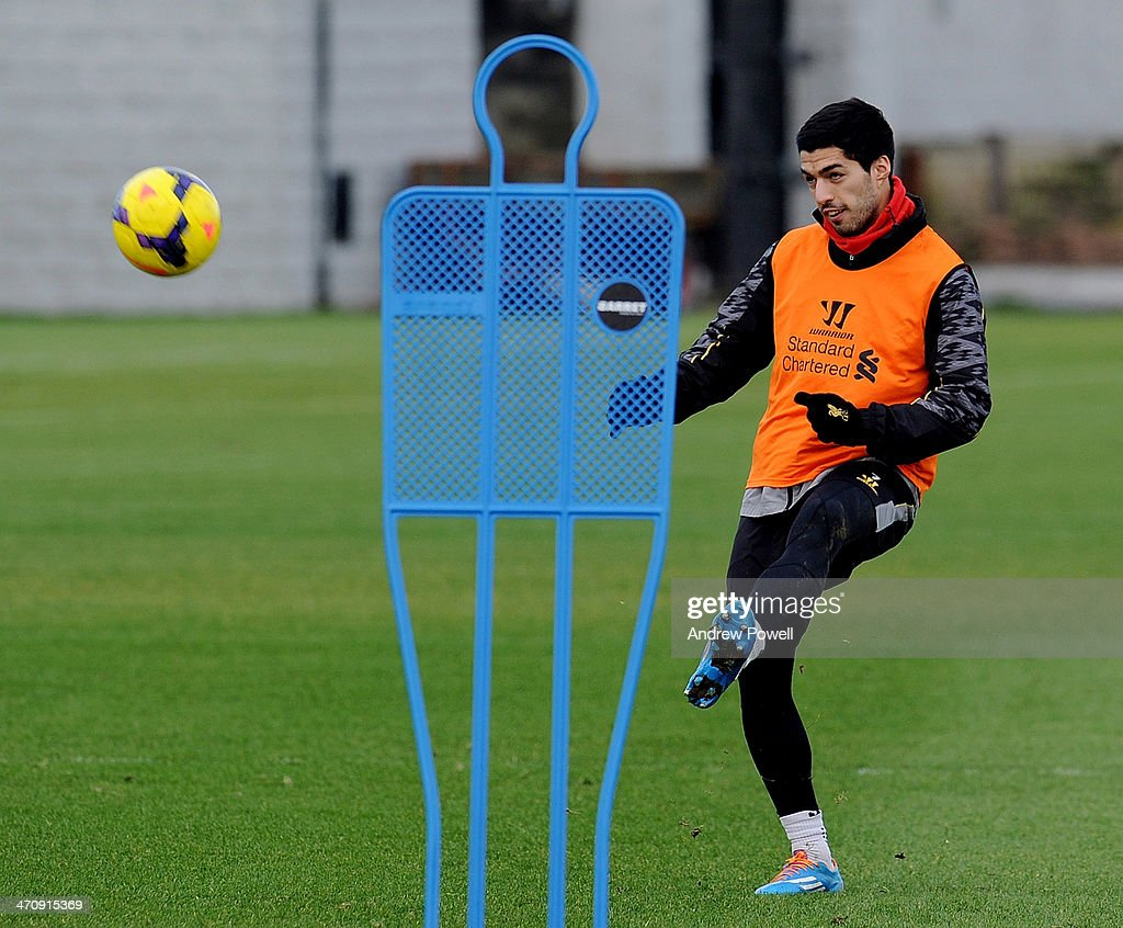 Luis Suarez of Liverpool in action during a training session at Melwood Training Ground on February 21, 2014 in Liverpool, England.