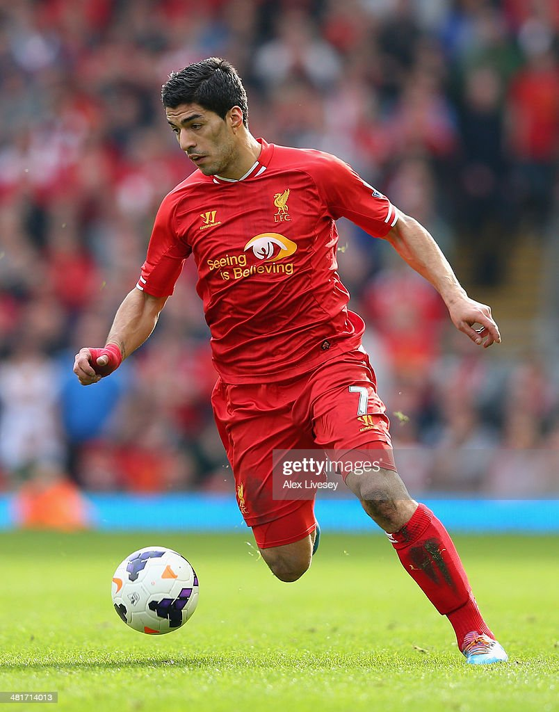 Luis Suarez of Liverpool in action during the Barclays Premier League match between Liverpool and Tottenham Hotspur at Anfield on March 30, 2014 in Liverpool, England.