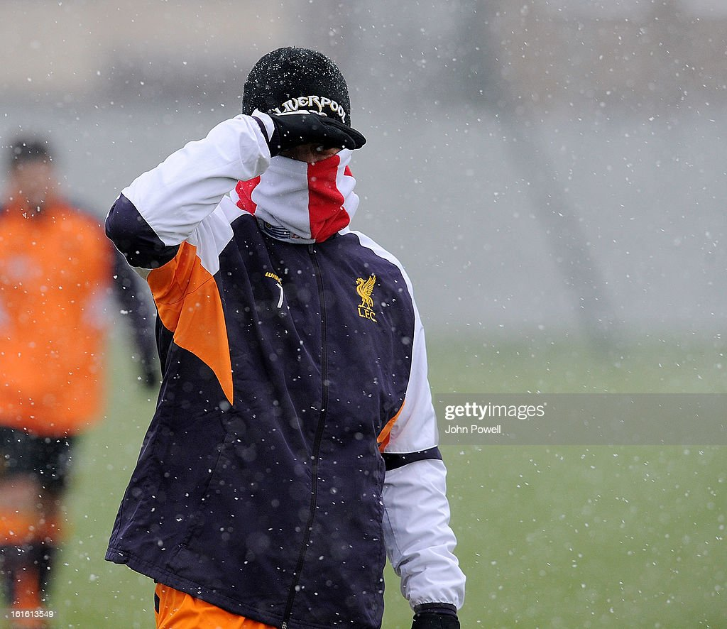 Luis Suarez of Liverpool in the snow during a training session at Melwood Training Ground on February 13, 2013 in Liverpool, England.