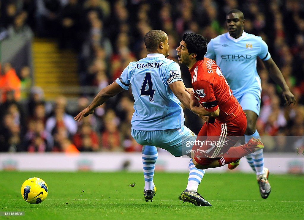 Luis Suarez of Liverpool is tackled by <a gi-track='captionPersonalityLinkClicked' href=/galleries/search?phrase=Vincent+Kompany&family=editorial&specificpeople=504694 ng-click='$event.stopPropagation()'>Vincent Kompany</a> of Manchester City during the Barclays Premier League match between Liverpool and Manchester City at Anfield on November 27, 2011 in Liverpool, England.