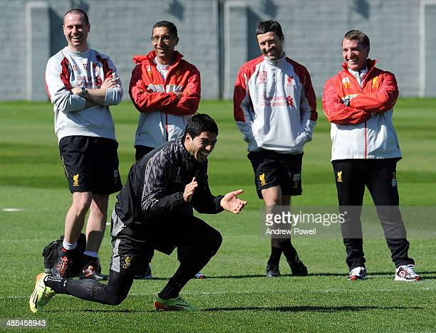 Luis Suarez of Liverpool laughs as Brendan Rodgers manager of Liverpool looks on nexte to Glen Driscoll Head of Performance Zaf Iqbal FirstTeam...