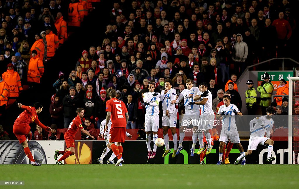 Luis Suarez of Liverpool levels the scores at 1-1 as he scores a goal from a free kick during the UEFA Europa League round of 32 second leg match between Liverpool FC and FC Zenit St Petersburg at Anfield on February 21, 2013 in Liverpool, England.