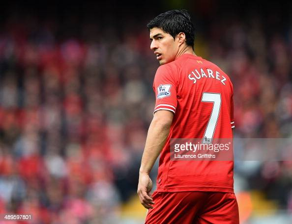 Luis Suarez of Liverpool looks on during the Barclays Premier League match between Liverpool and Newcastle United at Anfield on May 11 2014 in...