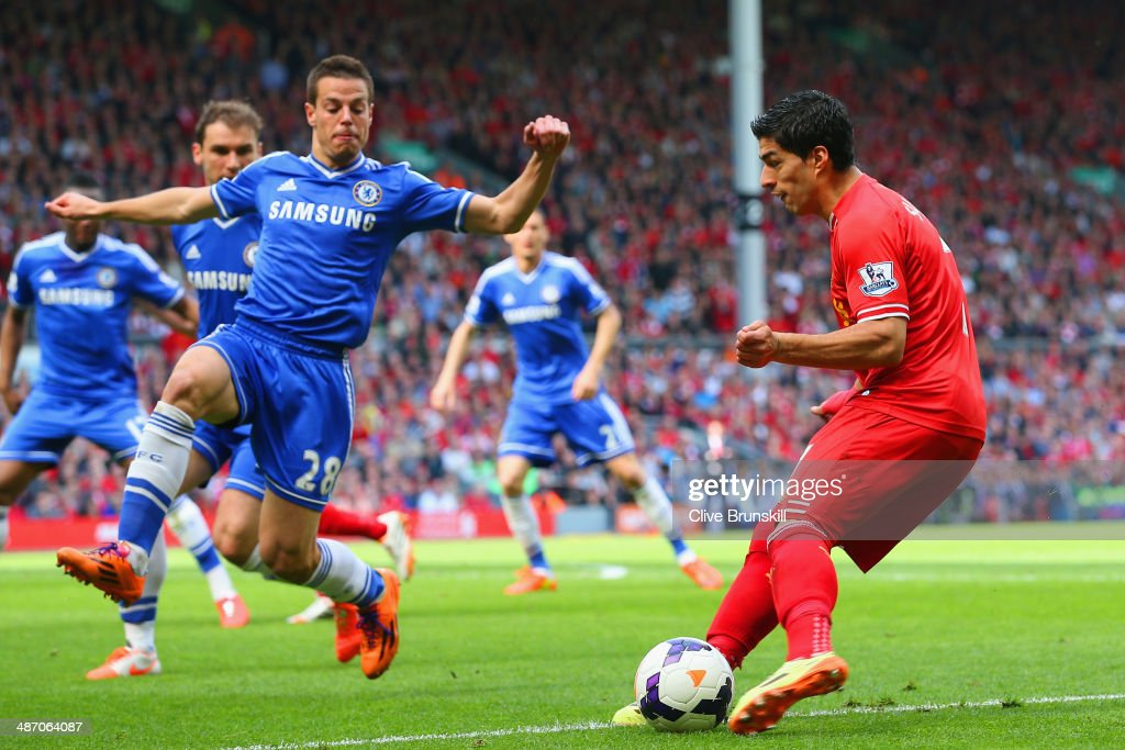 Luis Suarez of Liverpool looks to go past Cesar Azpilicueta of Chelsea during the Barclays Premier League match between Liverpool and Chelsea at Anfield on April 27, 2014 in Liverpool, England.