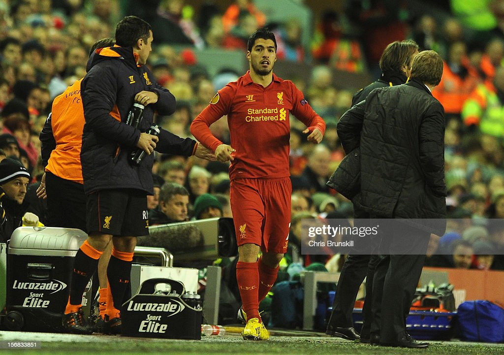 Luis Suarez of Liverpool prepares to come on as a substitute during the UEFA Europa League Group A match between Liverpool FC and BSC Young Boys at Anfield on November 22, 2012 in Liverpool, England.