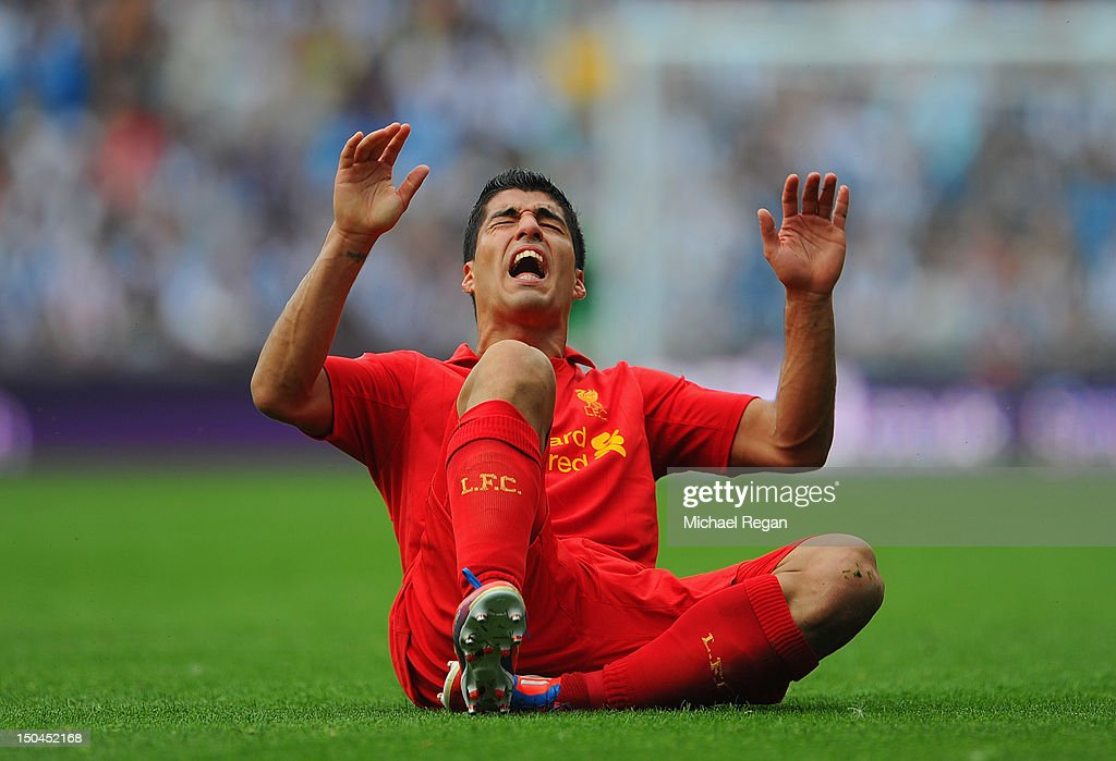 Luis Suarez of Liverpool reacts after being fouled during the Barclays Premier League match between West Bromwich Albion and Liverpool at The Hawthorns on August 18, 2012 in West Bromwich, England.