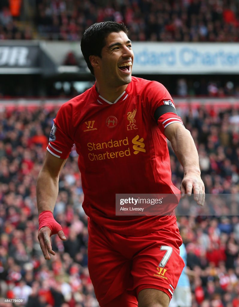 Luis Suarez of Liverpool reacts during the Barclays Premier League match between Liverpool and Manchester City at Anfield on April 13, 2014 in Liverpool, England.