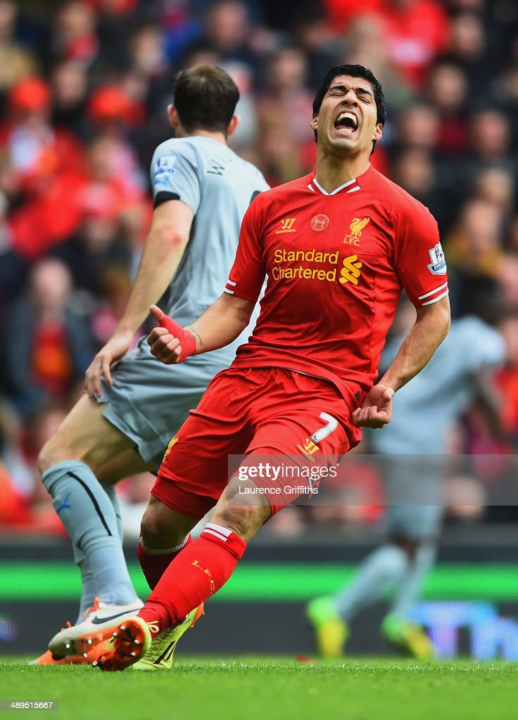Luis Suarez of Liverpool reacts during the Barclays Premier League match between Liverpool and Newcastle United at Anfield on May 11, 2014 in Liverpool, England.