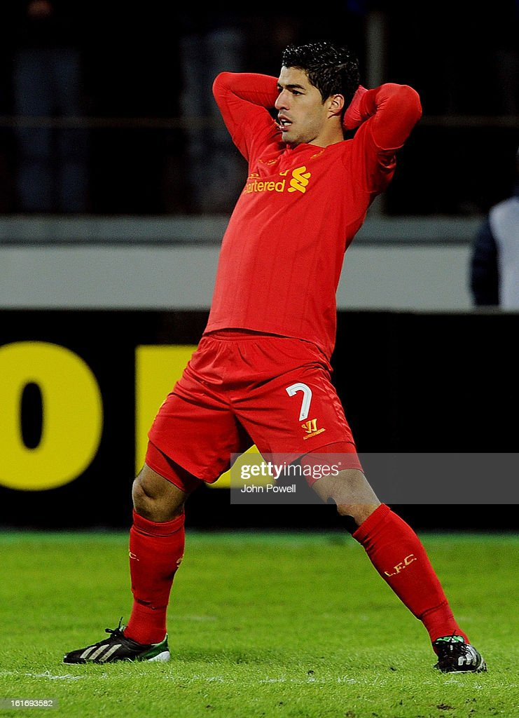 Luis Suarez of Liverpool reacts during the UEFA Europa League round of 32 first leg match between FC Zenit St Petersburg and Liverpool on February 14, 2013 in Saint Petersburg, Russia.
