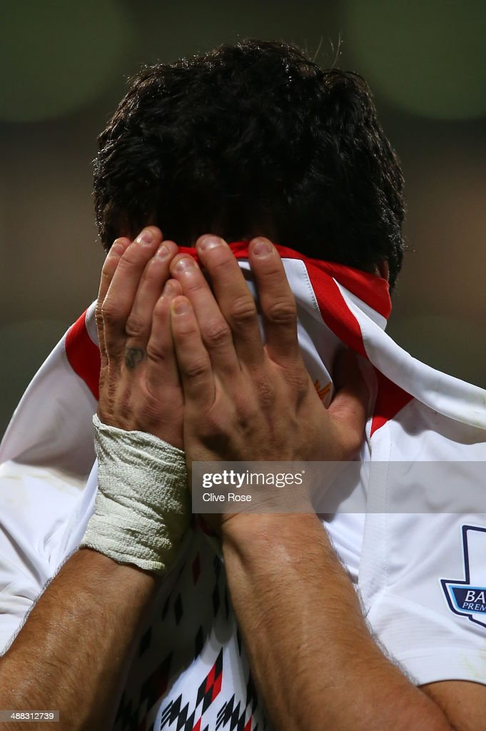 Luis Suarez of Liverpool reacts following his team's 3-3 draw during the Barclays Premier League match between Crystal Palace and Liverpool at Selhurst Park on May 5, 2014 in London, England.