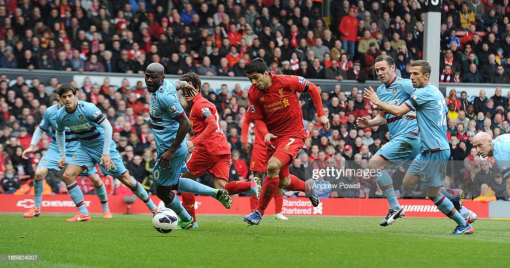 Luis Suarez of Liverpool runs through the West Ham defence during the Barclays Premier League match between Liverpool and West Ham United at Anfield on April 7, 2013 in Liverpool, England.