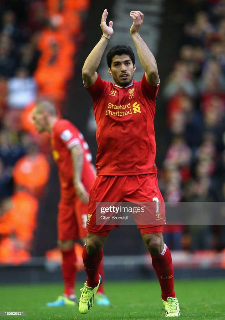 Luis Suarez of Liverpool salutes the crowd after scoring a hat-trick during the Barclays Premier League match between Liverpool and West Bromwich Albion at Anfield on October 26, 2013 in Liverpool, England.