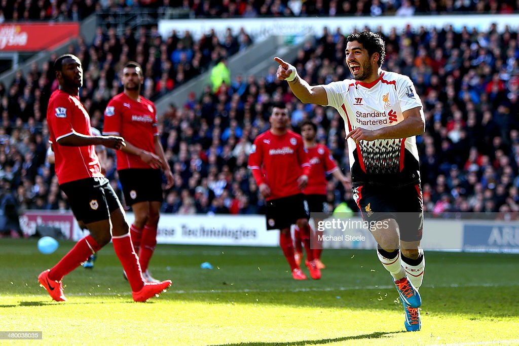 Luis Suarez of Liverpool scores a goal to level the scores at 11 during the Barclays Premier League match between Cardiff City and Liverpool at...