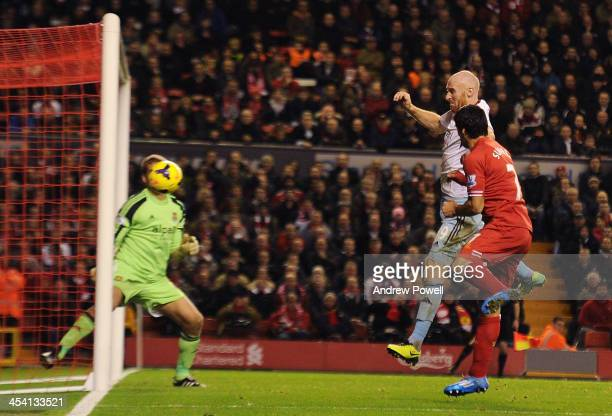 Luis Suarez of Liverpool scores his first goal during the Barclays Premier League match between Liverpool and West Ham United at Anfield on December...