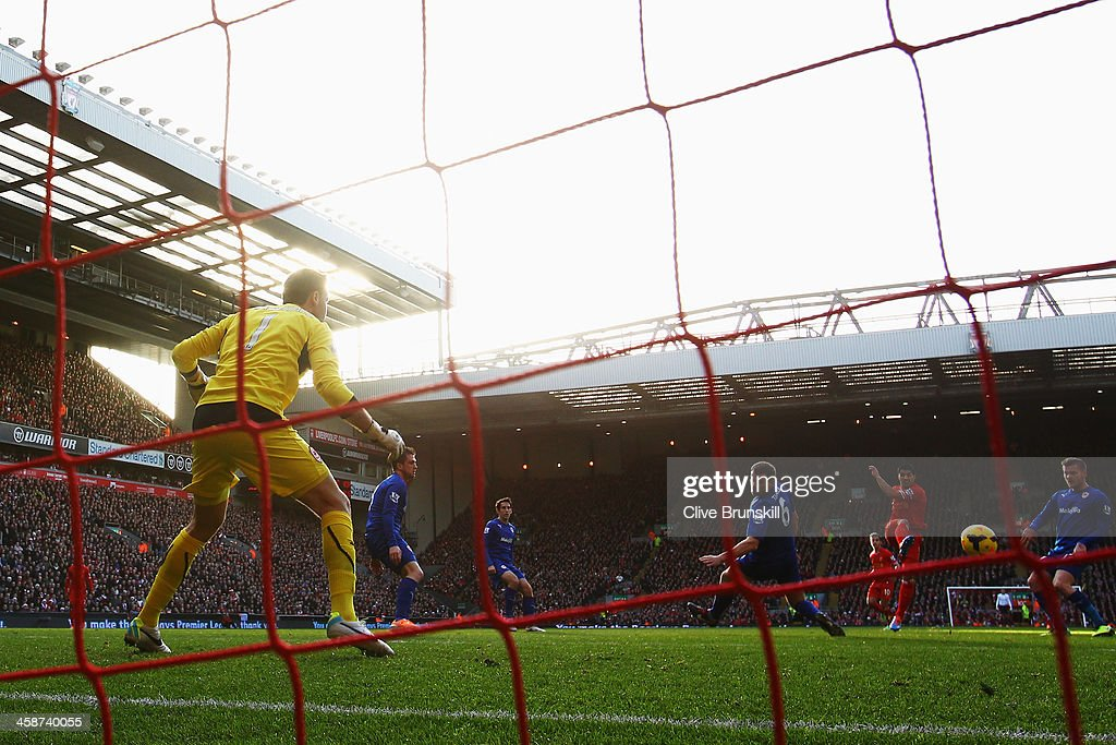 Luis Suarez (2nd right) of Liverpool scores his sides first goal during the Barclays Premier League match between Liverpool and Cardiff City at Anfield on December 21, 2013 in Liverpool, England.