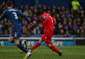 Luis Suarez of Liverpool scores his team's first goal during the FA Cup with Budweiser Fourth Round match between Oldham Athletic and Liverpool at...