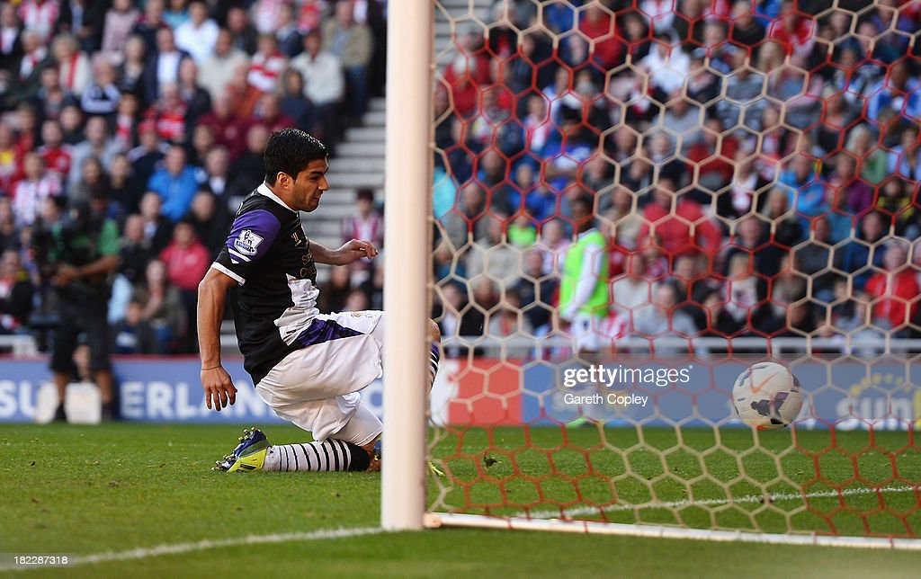 Luis Suarez of Liverpool scores his team's second goal during the Barclays Premier League match between Sunderland and Liverpool at the Stadium of Light on September 29, 2013 in Sunderland, England.
