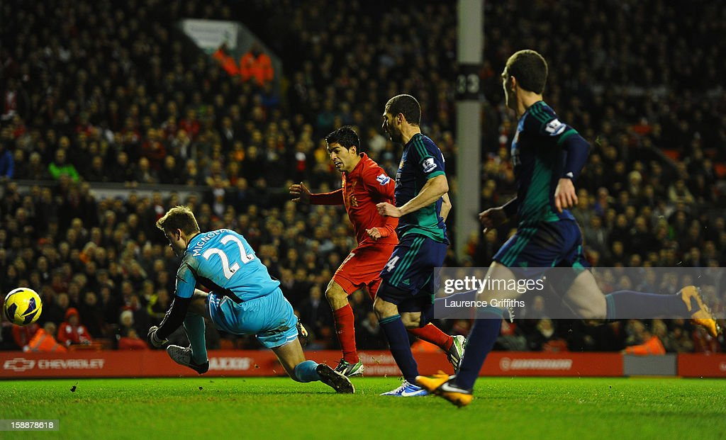 Luis Suarez of Liverpool scores his team's third goal during the Barclays Premier League match between Liverpool and Sunderland at Anfield on January 2, 2013 in Liverpool, England.