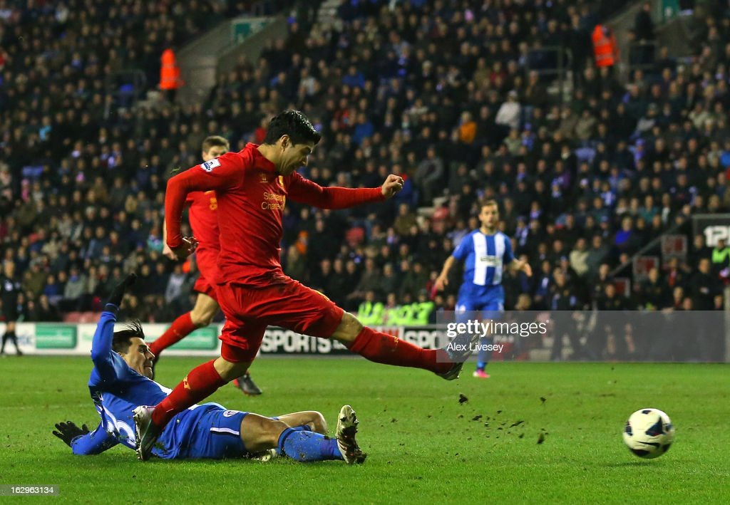 Luis Suarez of Liverpool scores his third goal to complete a hat trick during the Barclays Premier League match between Wigan Athletic and Liverpool at the DW Stadium on March 2, 2013 in Wigan, England.