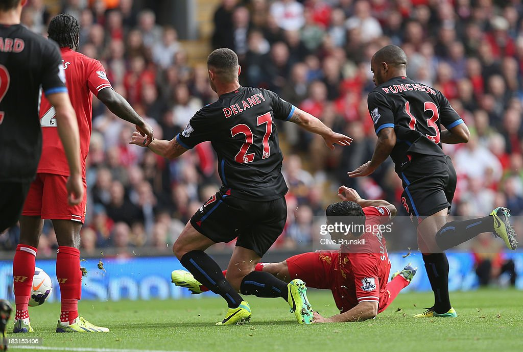 Luis Suarez of Liverpool scores the first goal during the Barclays Premier League match between Liverpool and Crystal Palace at Anfield on October 5, 2013 in Liverpool, England.