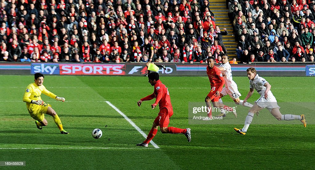 Luis Suarez of Liverpool scores the first goal to make it 1-0 during the Barclays Premier League match between Liverpool and Tottenham Hotspur at Anfield on March 10, 2013 in Liverpool, England.