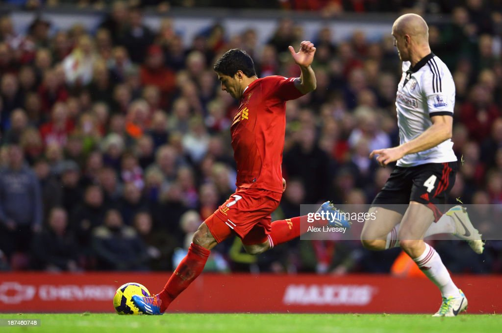 Luis Suarez of Liverpool scores the fourth goal during the Barclays Premier League match between Liverpool and Fulham at Anfield on November 9, 2013 in Liverpool, England.