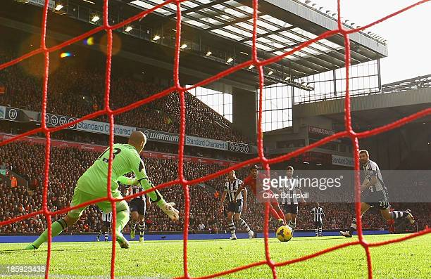 Luis Suarez of Liverpool scores the opening goal during the Barclays Premier League match between Liverpool and West Bromwich Albion at Anfield on...